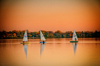Three Sailboats at Dusk