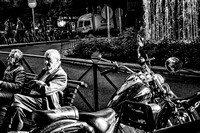 Old Man on Bench beside Motorcycle